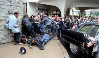 Chaos outside the Washington Hilton Hotel after the assassination attempt on President Reagan. James Brady and police officer Thomas Delahanty lie wounded on the ground. on 3/30/81.  (Reagan Presidential Library)