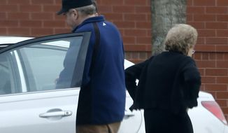 FILE - In this March 19, 2015 file photo, John Hinckley gets into his mother's car in front of a recreation center in Williamsburg, Va. A judge says Hinckley, who attempted to assassinate President Ronald Reagan will be allowed to leave a Washington mental hospital and live full-time in Virginia. (AP Photo/ Steve Helber, File)