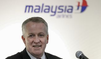 Malaysia Airlines Berhad (MAS) new Chief Executive Officer Peter Bellew smiles after a singing ceremony with Boeing in Putrajaya, Malaysia, Wednesday, July 27, 2016. Malaysia Airlines Berhad and Boeing announced today a deal of 50 new 737 Max aircraft. (AP Photo/Vincent Thian)