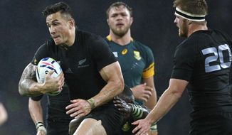 FILE - In this Oct. 24, 2015 file photo, New Zealand's Sonny Bill Williams runs with the ball during the Rugby World Cup semifinal match between New Zealand and South Africa at Twickenham Stadium in London. Williams passes for a superstar in this part of the world where rugby holds a rare pre-eminence over all other sports. When he competes in rugby sevens at the Olympics in Rio de Janiero next month it's likely his light, which shines brightly in Australasia, will be eclipsed by stars in sports with a more international reach.  (AP Photo/Christophe Ena, File)