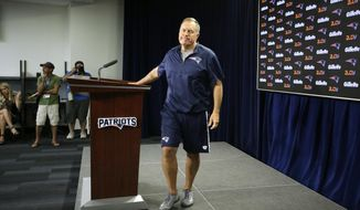 New England Patriots head coach Bill Belichick steps away from the podium after taking questions from reporters during a news conference at Gillette Stadium, Wednesday, July 27, 2016, in Foxborough, Mass. The Patriots' NFL football training camp is to begin Thursday, July 28. (AP Photo/Steven Senne)