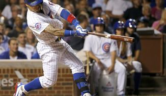 Chicago Cubs' Javier Baez hits a two-run home run off Chicago White Sox pitcher Anthony Ranaudo during the seventh inning of a baseball game Wednesday, July 27, 2016, in Chicago. (AP Photo/Charles Rex Arbogast)
