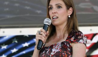 "Taya Kyle speaks about the statue of her late husband, Chris Kyle, before its unveiling Thursday, July 28, 2016 at the Chris Kyle Memorial Plaza in Odessa, Texas. A memorial for slain Navy Seal and ""American Sniper"" author Chris Kyle has been unveiled in the West Texas city where he was born in 1974. (Jacob Ford/Odessa American via AP)"