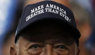 Former New York City Mayor David Dinkins wears a hat during the final day of the Democratic National Convention in Philadelphia, Thursday, July 28, 2016. (AP Photo/Carolyn Kaster)