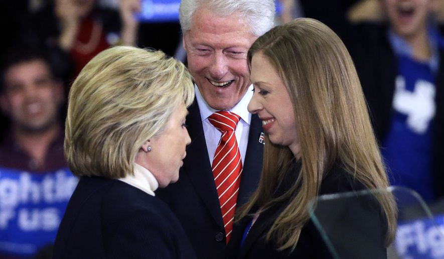 Democratic presidential candidate Hillary Clinton huddles with her husband, former President Bill Clinton and daughter Chelsea at her New Hampshire presidential primary campaign rally in Hooksett, N.H., Feb. 9, 2016. (AP Photo/Elise Amendola, File) ** FILE **