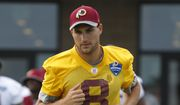 Washington Redskins quarterback Kirk Cousins (8) jogs to the field at the start of the NFL football teams training camp in Richmond, Va., Thursday, July 28, 2016. (AP Photo/Steve Helber)