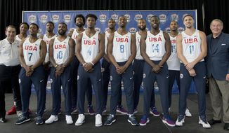 """FILE - In this June 27, 2016, file photo, the U.S. men's Olympic basketball team poses for a photo with  coach Mike Krzyzewski, left, and USA Basketball boss Jerry Colangelo, right, during a news conference in New York. The partnership of Krzyzewski and Colangelo took hold in the wake of the """"Abomination in Athens,"""" when a U.S. team coached by Larry Brown and packed with high-maintenance, highlight-reel guys who slept through wake-up calls couldn't rouse themselves in time for the medal round. They left the 2004 Summer Games with a consolation prize of bronze and the program's reputation in tatters. Colangelo, a former NBA and MLB executive and once a fine athlete in his own right, agreed to pick up the pieces on one condition: """"I get to make all the rules.""""  (AP Photo/Mary Altaffer, File)"""