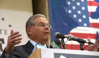 """U.S. Sen. Bob Menendez, D-N.J., speaks to New Jersey's Democratic delegates to the Democratic National Convention during a Thursday, July 28, 2016, breakfast at the Renaissance Philadelphia Airport Hotel in Philadelphia. Menendez said that Republican presidential nominee Donald Trump's comments about Russia exposing Democratic presidential candidate Hillary Clinton's emails are an """"act of treason."""" (Jose F. Moreno/Camden Courier-Post via AP)"""