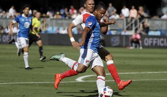 MLS All-Stars midfielder Giovani Dos Santos, front, of Los Angeles Galaxy, takes a shot on goal against Arsenal during the first half of the MLS All-Star soccer game Thursday, July 28, 2016, in San Jose, Calif. (AP Photo/Marcio Jose Sanchez)