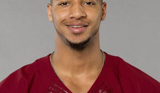 File-This is a 2016 photo of Josh Doctson of the Washington Redskins NFL football team. Training camp just started, and the Washington Redskins are already in no mood to mess with an Achilles tendon injury. First-round pick Doctson has been bothered by a sore left Achilles tendon since rookie minicamp in May, and the Redskins on Thursday, July 28, 2016, put the rookie wide receiver on the physically unable to perform list. (AP Photo)