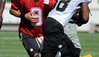 New Orleans Saints quarterback Drew Brees (9) hands the ball off  to a teammate during the NFL football teams training camp in White Sulphur Springs, W.Va., Thursday, July 28, 2016. (AP Photo/Chris Tilley)
