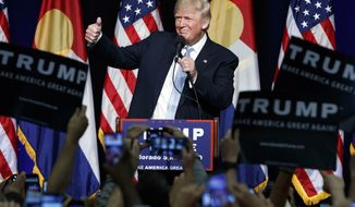 Republican presidential candidate Donald Trump gives a thumbs up as he speaks during a campaign rally, Friday, July 29, 2016, in Colorado Springs, Colo. (AP Photo/Evan Vucci)