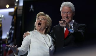 Democratic presidential nominee Hillary Clinton and former President Bill Clinton react as balloons fall during the final day of the Democratic National Convention in Philadelphia on July 28, 2016. (Associated Press) **FILE**
