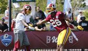 Washington Redskins wide receiver DeSean Jackson, left, and cornerback Bashaud Breeland (26) react to a pass play during the afternoon practice at the Washington Redskins NFL football teams training camp in Richmond, Va., Friday, July 29, 2016. (AP Photo/Steve Helber)