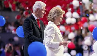Former President Bill Clinton, left, joins his wife Democratic presidential candidate Hillary Clinton on stage during the fourth day session of the Democratic National Convention in Philadelphia, Thursday, July 28, 2016. (AP Photo/Andrew Harnik)