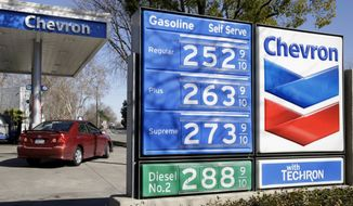 In this Monday, Feb. 8, 2016, file photo, gas prices are displayed at a Chevron gas station in Sacramento, Calif. Chevron reports financial results Friday, July 29, 2016. (AP Photo/Rich Pedroncelli, File)