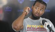 Washington Redskins strong safety Josh Norman (24) gestures as he talks to the media after the morning practice at the Redskins NFL football teams training camp in Richmond, Va., Friday, July 29, 2016. Norman was a former Carolina Panther. (AP Photo/Steve Helber)