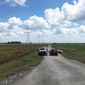 Police cars block access to the site where a hot air balloon crashed early Saturday, July 30, 2016, near Lockhart, Texas.  At least 16 people were on board the balloon, which Federal Aviation Administration spokesman Lynn Lunsford said caught fire before crashing into a pasture shortly after 7:40 a.m. Saturday near Lockhart. No one appeared to survive the crash, authorities said. (AP Photo/James Vertuno)