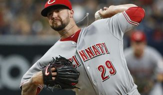 Cincinnati Reds starting pitcher Brandon Finnegan works against the San Diego Padres during the first inning of a baseball game Friday, July 29, 2016, in San Diego. (AP Photo/Lenny Ignelzi)