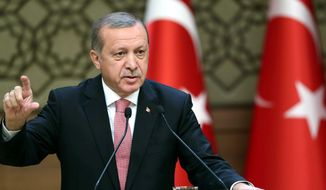 "Turkish President Recep Tayyip Erdogan, lashing out Tuesday at Amnesty International said his government has ""zero tolerance toward torture."" (Associated Press)"