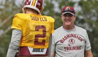Washington Redskins head coach Jay Gruden talks with quarterback Nate Sudfeld during the afternoon practice at NFL football training camp in Richmond, Va., Tuesday, Aug. 2, 2016. (AP Photo/Steve Helber)