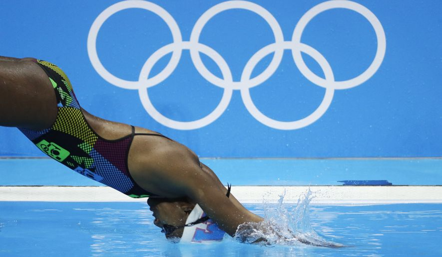 An Unidentified Athlete Jumps Into The Olympic Pool During A Swimming Training Session Before