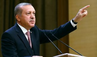 """Turkey's President Recep Tayyip Erdogan speaks during an event for foreign investors, in Ankara, Turkey, on Tuesday, Aug. 2, 2016. Erdogan said, once more blasted unnamed Western countries which he says supported an attempted coup on July 15 which left more than 270 people dead. """"The West is supporting terrorism and taking sides with coups."""" (Kayhan Ozer/Presidential Press Service, Pool Photo via AP)"""