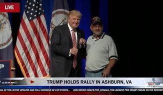A man Donald Trump introduced as retired Lt. Col. Louis Dorfman presented the Republican presidential nominee with his Purple Heart during a rally Tuesday in Virginia. (YouTube/@Right Side Broadcasting)