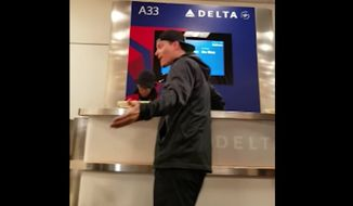 Vanilla Ice was caught on video berating a Delta Airlines employee and fellow passengers after he missed a flight Monday at Atlanta's Hartsfield-Jackson International Airport. (YouTube/@China K)