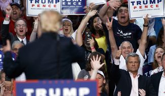 Republican presidential candidate Donald Trump waves to supporters during a campaign town hall at Ocean Center, Wednesday, Aug. 3, 2016, in Daytona Beach, Fla. (AP Photo/Evan Vucci)