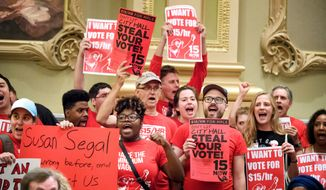 Members of 15 Now, NOC, CTUL and other groups rally at the Minneapolis City Council Chambers, Wednesday, Aug. 3, 2016, trying to get a $15 minimum wage on the Minneapolis ballot in November. (Glen Stubbe/Star Tribune via AP) ** FILE **