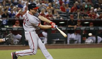 Washington Nationals' Max Scherzer connects for a two-run single against the Arizona Diamondbacks during the sixth inning of a baseball game Wednesday, Aug. 3, 2016, in Phoenix. (AP Photo/Ross D. Franklin)