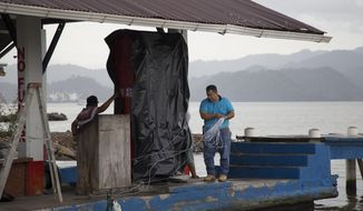 A marine gas station is shut down as it prepares for the arrival of Hurricane Earl, in Puerto Barrios, Guatemala, Tuesday, Aug. 3, 2016. Hurricane Earl bore down on the coast of the Caribbean nation of Belize with the danger of high surf and winds, while also threatening neighboring Guatemala and southern Mexico with torrential rains. (AP Photo/Luis Soto)