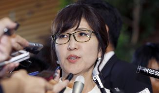 Japan's newly-appointed Defense Minister Tomomi Inada answer questions from reporters at the prime minister's official residence in Tokyo, Wednesday, Aug. 3, 2016. Prime Minister Shinzo Abe changed more than half of the 19-member Cabinet on Wednesday in a bid to support his economic, security and other policy goals. (AP Photo/Shizuo Kambayashi)