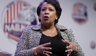 Attorney General Loretta Lynch speaks to the National Association of Black Journalists and National Association of Hispanic Journalists at their convention in Washington on Aug. 4, 2016. (Associated Press) **FILE**