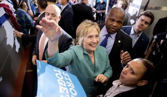 Democratic presidential candidate Hillary Clinton greets members of the audience after speaking at a rally at International Brotherhood of Electrical Workers Local 357 Hall, in Las Vegas, Thursday, Aug. 4, 2016. (AP Photo/Andrew Harnik) ** FILE **