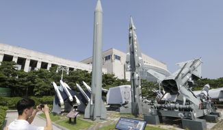 A mock Scud-B missile of North Korea, left, and other South Korean missiles are displayed at the Korea War Memorial Museum in Seoul, South Korea, Friday, Aug. 5, 2016. North Korea has fired a barrage of missiles, artillery pieces and rockets into the waters off its east coast, including a medium-range ballistic missile that fell near Japan's territorial waters this week. (AP Photo/Ahn Young-joon)