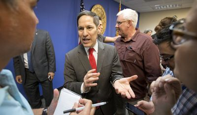 Centers for Disease Control and Prevention Director Dr. Tom Frieden, center, gestures as he speaks with members of the media after a news conference, Thursday, Aug. 4, 2016, in Doral, Fla. The CDC has warned expectant mothers to steer clear of the city's Wynwood neighborhood, where at least 15 people are believed to have been infected with the Zika virus through mosquito bites in the first such cases on record in the mainland U.S. (AP Photo/Wilfredo Lee)