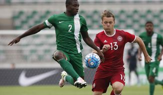 FILE - In this June 4, 2016, file photo, Nigeria's Sincere Muenfuh Seth, left, controls the ball against Denmark's Emil Larsen during a 4 Nations International U-23 soccer tournament at the Goyang Stadium in Goyang, South Korea. Sincere Muenfuh Seth, member of the Nigerian men's Olympic soccer team, and his teammates had their trip to the Rio Games delayed by a mix-up at the airport, forcing the club to board a last-minute flight from Atlanta to Brazil just hours before its opening match. (AP Photo/Lee Jin-man, File)