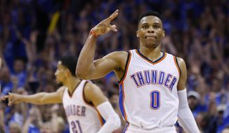 FILE - In this May 12, 2016, file photo, Oklahoma City Thunder guard Russell Westbrook (0) gestures following a three-point basket in the fourth quarter of Game 6 of a second-round NBA basketball playoff series against the San Antonio Spurs,  in Oklahoma City.  A source with direct knowledge of the situation says the Thunder have reached a new deal with All-Star guard Russell Westbrook. The two sides have agreed on a new three-year contract worth $85.7 million. The person spoke to The Associated Press on condition of anonymity Thursday, Aug. 4, 2016,  because the team had not announced the deal. (AP Photo/Alonzo Adams, File)