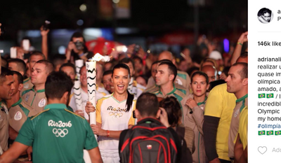 Brazilian supermodel Adriana Lima, carrying the Olympic torch as it makes its way to Rio. From her Instagram account.