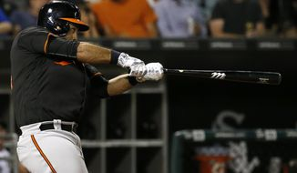 Baltimore Orioles' Pedro Alvarez hits a solo home run against the Chicago White Sox during the eighth inning of a baseball game Friday, Aug. 5, 2016, in Chicago. (AP Photo/Nam Y. Huh)