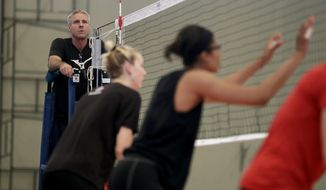 United States women's volleyball head coach Karch Kiraly, left, watches as members of his team practice at the Navy School High Performance Training Center before the start of the 2016 Summer Olympics in Rio de Janeiro, Brazil, Thursday, Aug. 4, 2016. (AP Photo/Jeff Roberson)