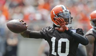 Cleveland Browns quarterback Robert Griffin III plays in their orange and brown scrimmage at the NFL football team's training camp Saturday, Aug. 6, 2016, in Columbus, Ohio. (AP Photo/Jay LaPrete)