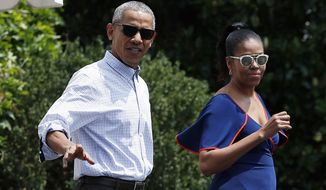 President Barack Obama and first lady Michelle Obama walk from the White House, Saturday, Aug. 6, 2016, in Washington, to board Marine One, with their daughters Sasha and Malia, en route to Andrews Air Force Base, Md., and on to Martha's Vineyard for a family vacation. (Associated Press) **FILE**