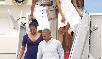 President Barack Obama and first lady Michelle Obama exit Air Force One followed by daughters Sasha, left, and Malia, right, at the Cape Cod Coast Guard Station in Bourne, Mass., Saturday, Aug. 6, 2016, en route to Martha's Vineyard. (AP Photo/Stew Milne)