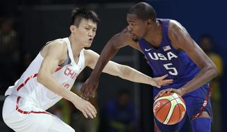 United States' Kevin Durant (5) drives past China's Zou Peng, left, during a basketball game at the 2016 Summer Olympics in Rio de Janeiro, Brazil, Saturday, Aug. 6, 2016. (AP Photo/Charlie Neibergall)
