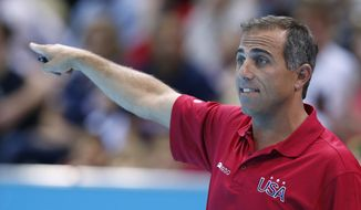 FILE - In this Aug. 3, 2012 file photo, United States women's water polo coach Adam Krikorian shouts to his players as they play China during a preliminary round match at the 2012 Summer Olympics in London. Krikorian left his team during the 2016 Summer Olympics in Rio de Janeiro, Brazil to be with his family after one of his two older brothers died, according to a team spokesperson. (AP Photo/Alastair Grant, File)