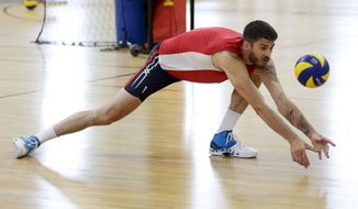 In this May 25, 2016 photo, Olympic volleyball player Matt Anderson, of the United States, lunges for a ball during practice, in Anaheim, Calif. In late 2014, Anderson found himself in a deep funk and made that daunting decision to step away from volleyball to find himself. Eventually, he found his way back, and Anderson will lead the Americans into their Olympic opener Sunday, Aug. 7, against Canada. (AP Photo/Chris Carlson)