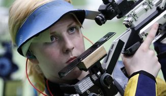 Virginia Thrasher of the United States competes during the Women's 10m Air Rifle Qualification at Olympic Shooting Center at the 2016 Summer Olympics in Rio de Janeiro, Brazil, Saturday, Aug. 6, 2016. (AP Photo/Hassan Ammar)